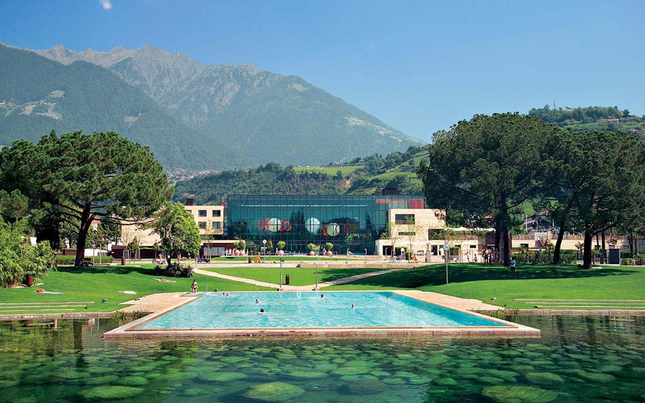 Open-air pool in the garden, SPA building and the mountains around Merano