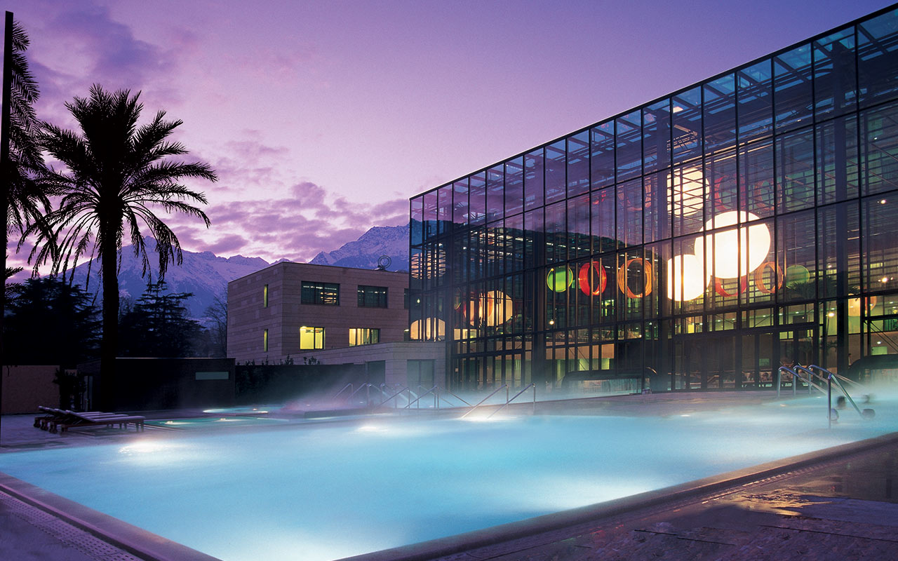 Hot water pool on the outside and Terme di Merano building in the background