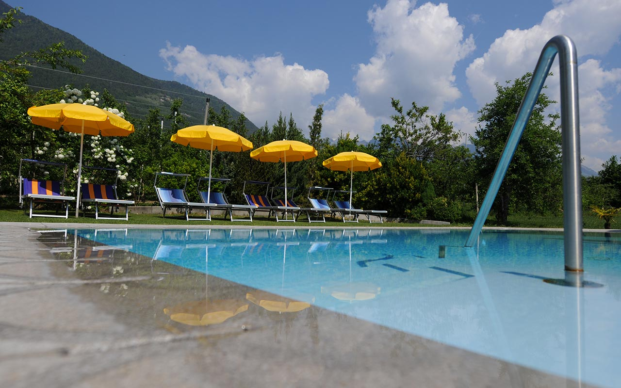 Pool with yellow beach umbrellas and deck-chairs