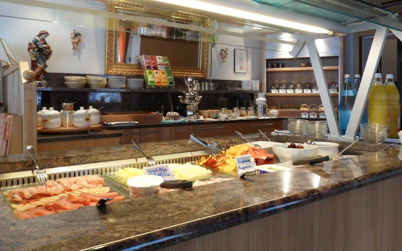 Buffet for breakfast at Hotel FleurAlp with sweet and salted products
